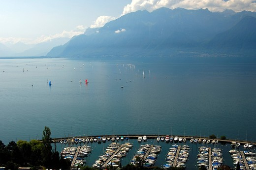 Port de la Pichette marina in Corseaux on Lake Geneva, Vaud, Switzerland, in front of the Savoy Alps in France, Europe : Stock Photo
