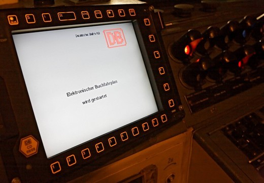 Electronic timetable in a 218 series diesel locomotive from 1972 showing the current situation on the rails of the Deutsche Bahn AG : Stock Photo