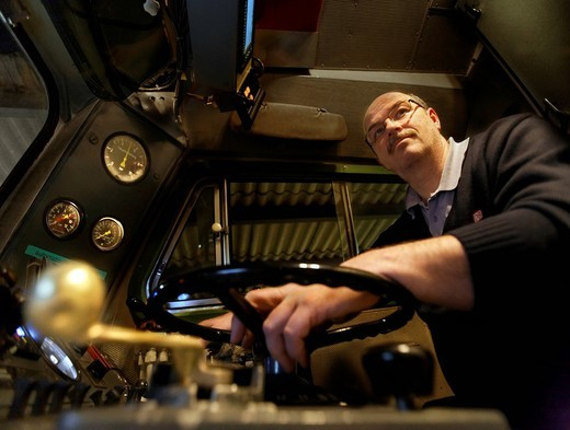Stock Photo: 1848-444589 Peter Deissler, a train driver driving a 218 series diesel locomotive from 1972 on a regional express train from the Deutsche Bahn AG, between Heilbronn and Stuttgart, Baden_Wuerttemberg, Germany, Europe