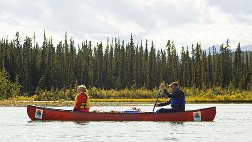 Stock Photo: 1848-444688 Couple, man and woman in a canoe, canoeing, Takhini River, Yukon Territory, Canada