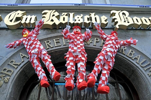Nubbel strawmen hanging during the carnival days in Cologne above the door of a bar, at midnight on Carnival Tuesday they will be carried amid great lamentations to the grave, Cologne, North Rhine_Westphalia, Germany, Europe : Stock Photo