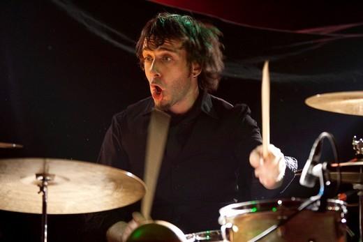 Stock Photo: 1848-445408 Little Konzett, drummer of the US singer and songwriter Matt Boroff live in the Schueuer venue, Lucerne, Switzerland