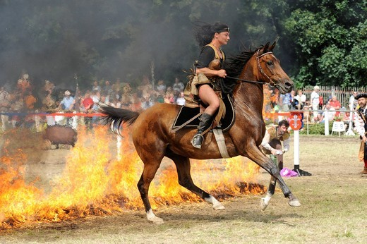 Woman dressed as an Amazon, riding a horse through fire, Wenigenauma Ponyshow, Thuringia, Germany, Europe : Stock Photo