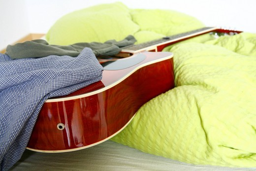 Stock Photo: 1848-446332 Messy room, student room with a guitar