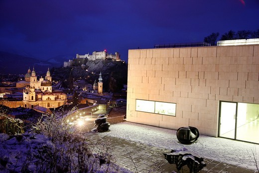 Museum der Moderne museum, Mt. Moenchsberg, view of the old town with the Kollegienkirche church, the cathedral and Festung Hohensalzburg fortress, in the evening, winter, Salzburg, Austria, Europe : Stock Photo
