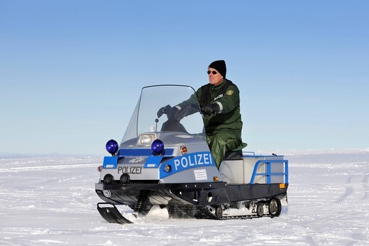 Stock Photo: 1848-446780 Snowmobile used as a police vehicle by the National Police Directorate Freiburg on Mt. Feldberg in the Black Forest, Landkreis Breisgau_Hochschwarzwald district, Baden_Wuerttemberg, Germany, Europe