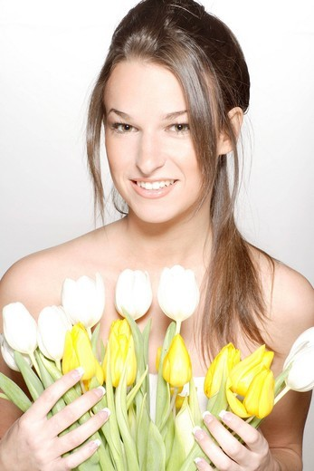 Stock Photo: 1848-446890 Young woman, tulips, portrait