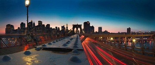 Panoramic view of Brooklyn Bridge and Manhatten by night, New York City, New York, USA, North America : Stock Photo