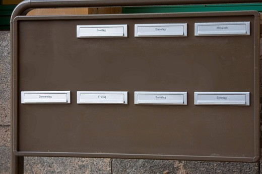 Letterbox system with mailboxes, weekdays, weekly planning : Stock Photo