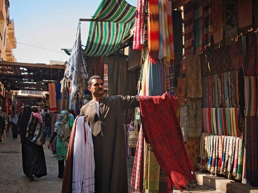Cloth merchant in the souk of Luxor, Egypt, Africa : Stock Photo