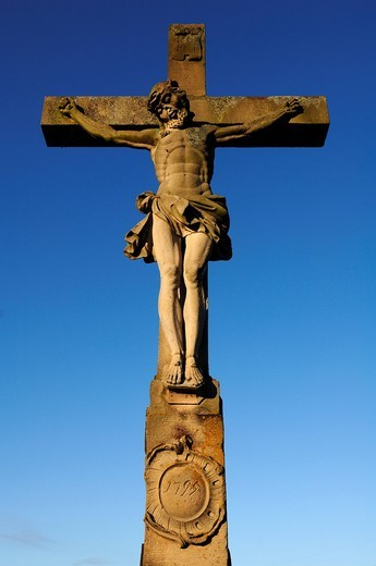 Stone crucifix from 1795 against a blue sky, Illhaeusern, Alsace, France, Europe : Stock Photo
