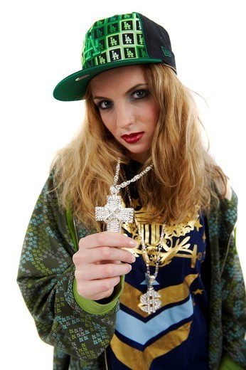 Young girl in rapper outfit : Stock Photo
