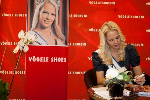 Stock Photo: 1848-450873 Linda Faeh, Miss Switzerland 2009, at an autograph session in the Emmencenter, Emmen, Lucerne, Switzerland