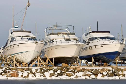 Three drydocked motor boats in Dragoer harbour, Denmark, Europe : Stock Photo