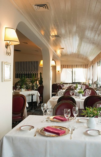 Set table in a restaurant, L´Oca Bianca, Viareggio, Tuscany, Italy, Europe : Stock Photo