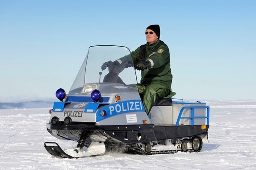 Stock Photo: 1848-451524 Snowmobile used as a police vehicle by the National Police Directorate Freiburg on Mt. Feldberg in the Black Forest, Landkreis Breisgau_Hochschwarzwald district, Baden_Wuerttemberg, Germany, Europe