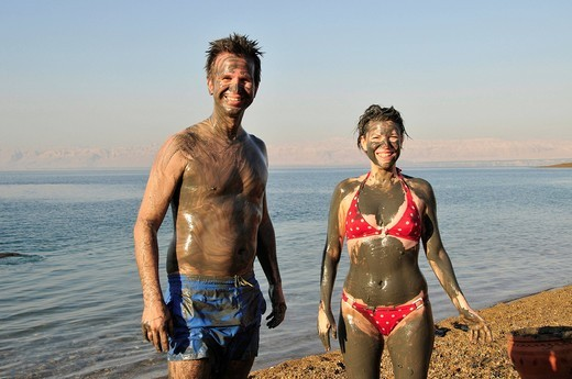 Tourists smeared with salty mud from the Dead Sea, near Suwaymah, Jordan, Middle East, Orient : Stock Photo