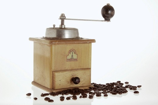 Old coffee grinder with coffee beans : Stock Photo