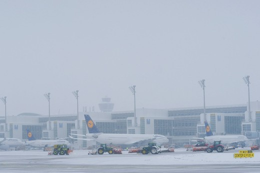 Stock Photo: 1848-452667 Snow, winter, snow removal with tractors, aircraft, taxiway, control tower, Terminal 2, east apron, Munich Airport, MUC, Bavaria, Germany, Europe