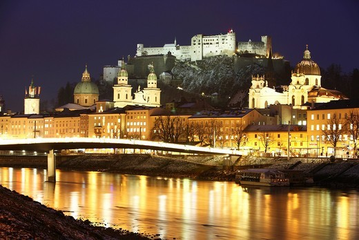 Old town with Kollegienkirche church, the Salzburger Dom cathedral and Festung Hohensalzburg fortress, Salzach river, at night, winter, Salzburg, Austria, Europe : Stock Photo