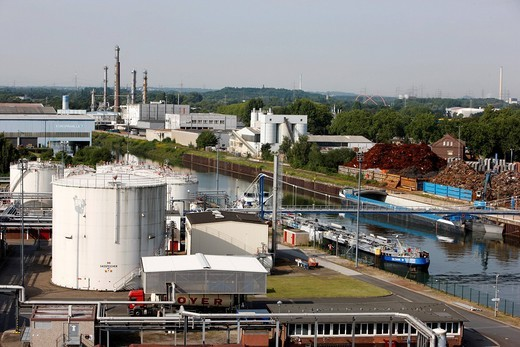 Stock Photo: 1848-452756 Tank and terminal facilities of Deutsche BP AG, storage tanks for various petroleum products, port of Gelsenkirchen, at the Rhine_Herne Canal, Gelsenkirchen, North Rhine_Westphalia, Germany, Europe