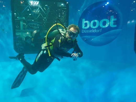 Stock Photo: 1848-453240 Diver in the diving tower, at the Boot 2010, world´s largest exhibition for yachts and water sports, Duesseldorf, North Rhine_Westphalia, Germany, Europe