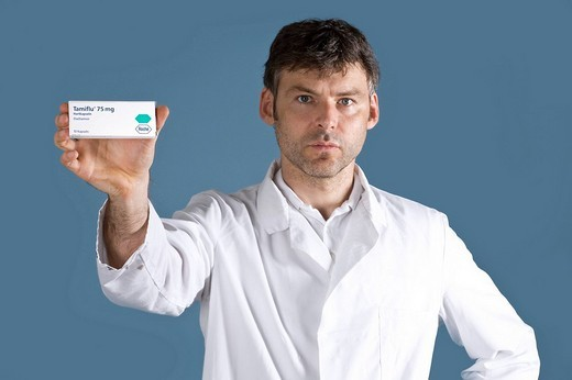 Doctor presenting the drug Tamiflu : Stock Photo