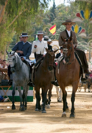 Scene during a traditional Spanish Feria festival in the Andalucian city Utrera, Spain, Europe : Stock Photo