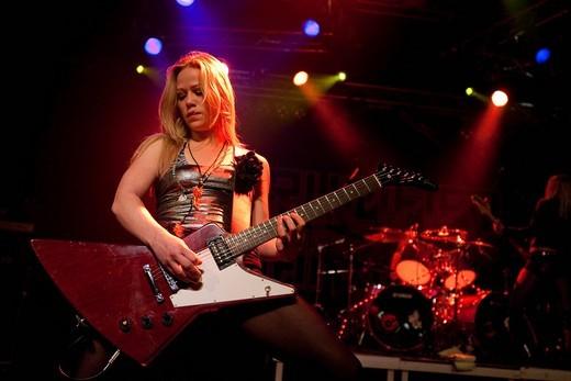 Klara Force, guitarist of the Swedish all_female heavy metal band Crucified Barbara live in the Transilvania venue in Erstfeld, Uri, Switzerland : Stock Photo