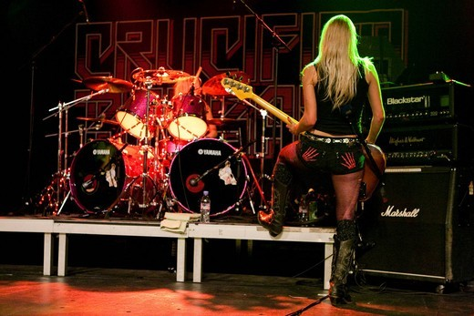 Ida Evileye, bassist of the Swedish all_female heavy metal band Crucified Barbara live in the Transilvania venue in Erstfeld, Uri, Switzerland : Stock Photo