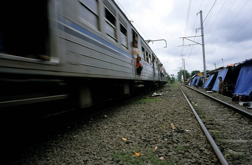 Train passing through the slums of Jakarta, Indonesia, Java, Asia : Stock Photo