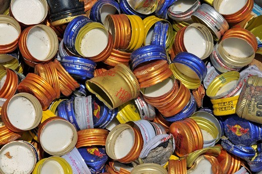 Stock Photo: 1848-455313 Inhabitants of the slum Bang Sue live of waste recycling, here sorted screw_caps of beverage bottles, Bang Sue, Thailand, Asia