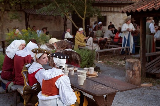 Women sitting at a table in a restaurant during the Medieval Week in Visby, Gotland Island, Sweden, Scandinavia, Europe : Stock Photo