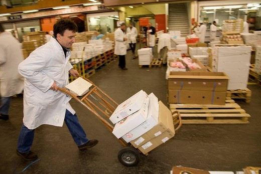 Francois Pasteau, chef from the L´Epi Dupin restaurant in the meat and poultry hall, Produits carnes, Rungis wholesale market near Paris, France, Europe : Stock Photo