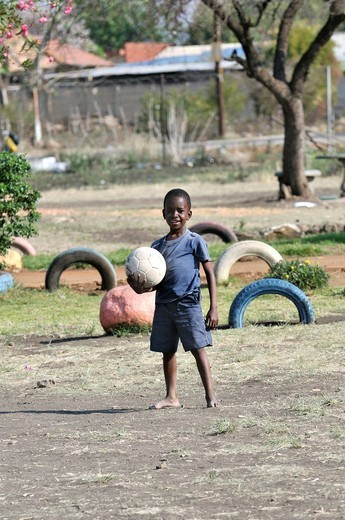 Boy holding a football, Cape Town, South Africa, Africa : Stock Photo