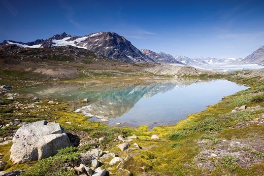 Mountain lake with a reflection, Sermiligâq Fjord, Ammassalik District, East Greenland, Greenland, Denmark, Europe : Stock Photo