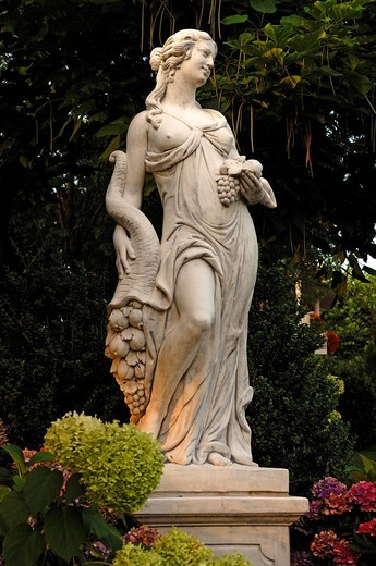 Female statue with a cornucopia, in the park of the Rebstock hotel_restaurant, Halbguetle 30, Durbach, Baden_Wuerttemberg, Germany, Europe : Stock Photo