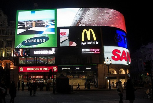 Neon advertising signs, billboard screens, pedestrians, Piccadilly Circus, London, England, UK : Stock Photo