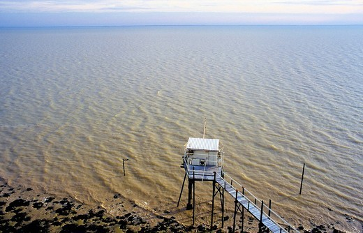 Traditional fisherman´s hut on stilts, Senknetz fishing, estuary of the Gironde, Aquitaine, France, Europe : Stock Photo