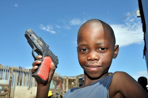 Boy with toy gun, Queenstown, Eastern Cape, South Africa, Africa : Stock Photo