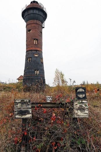 Wasserturm Nord water tower and an overgrown railway buffer stop, abandoned railway yard in Duisburg Wedau, Ruhr area, North Rhine_Westphalia, Germany, Europe : Stock Photo