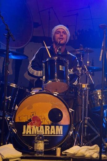 Murxen Alberti, drummer of the German Reggae band Jamaram live at the Schueuer concert hall, Lucerne, Switzerland : Stock Photo