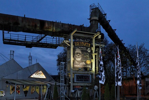 Stock Photo: 1848-461107 Poster for a Halloween party hanging on an industrial backdrop at night, Delta Music Park, Duisburg Nord, Ruhr area, North Rhine_Westphalia, Germany, Europe