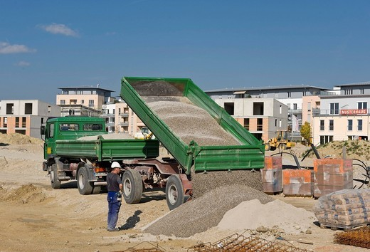 Stock Photo: 1848-461992 MAN 18_284 truck with trailer delivering gravel to the construction site Am Burgerfeld in Markt Schwaben, Bavaria, Germany, Europe