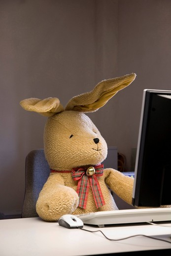 Stock Photo: 1848-462224 Felix, a toy rabbit, seated at a desk