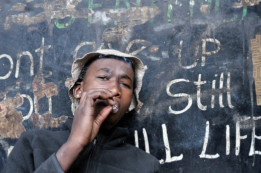 Street child consuming drugs, marijuana, boy smoking a joint, in Hillbrow, Johannesburg, South Africa, Africa : Stock Photo