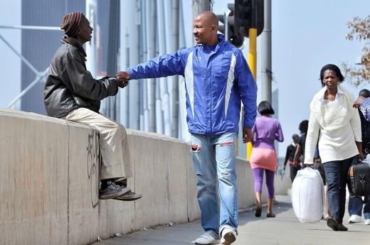 Street child begging on the Mandela Bridge, Johannesburg, South Africa, Africa : Stock Photo
