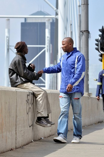 Street child begging on the Mandela Bridge, Johannesburg, South Africa, Africa : Stock Photo