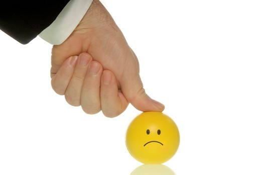 Stock Photo: 1848-462417 Businessman pressing his thumb down on a smiley, symbolic image for pressure to perform