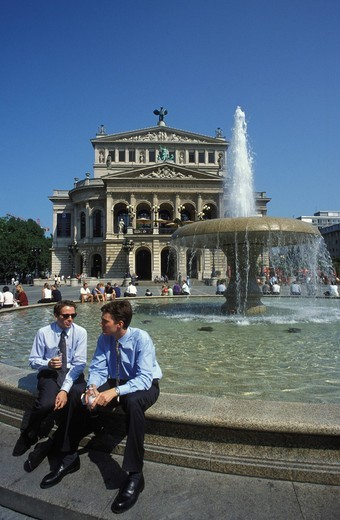 Two business people in front of the Alte Oper opera house in Frankfurt, Hesse, Germany, Europe : Stock Photo